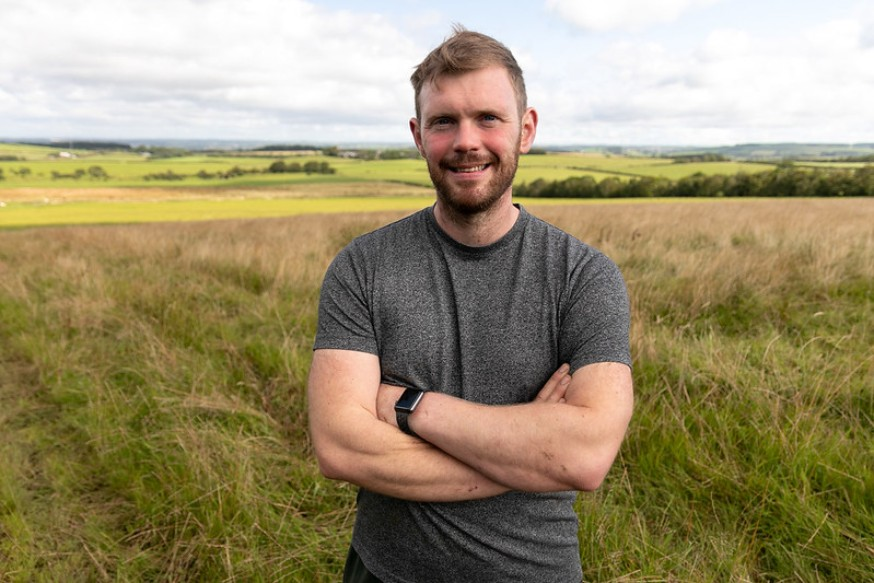 Photo of Bryce Cunningham smiling. Bryce is a young farming climate champion.