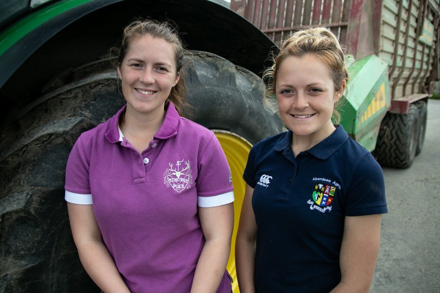Photo of Kirsty and Aimee smilling. Both are young farming climate change champions.